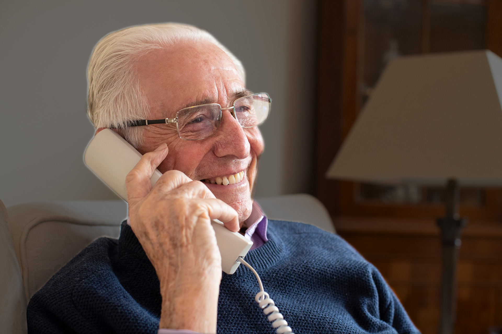 Elderly Man receiving Care Light Personal Contact phone call